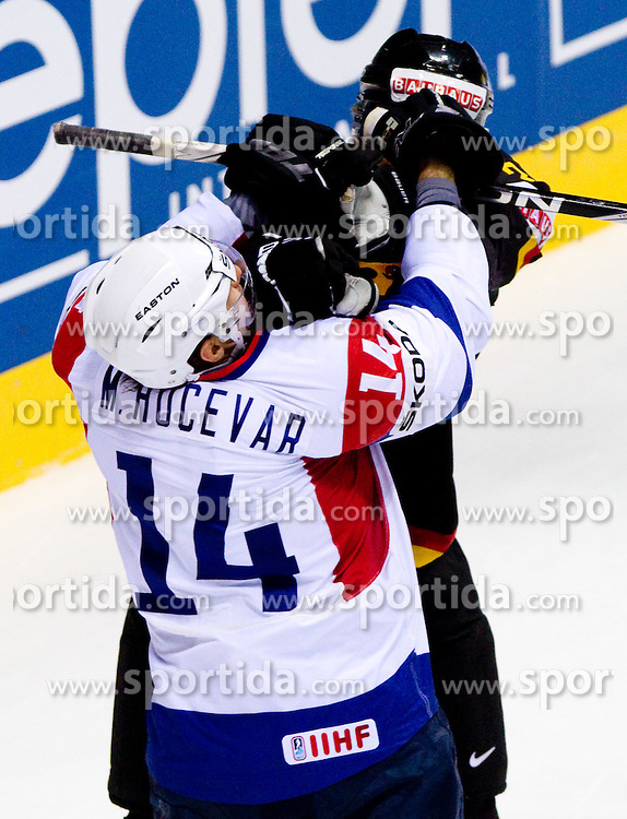 Matej Hocevar of Slovenia in fight with Justin Krueger of Germany during ice-hockey match between Slovenia and Germany of Group A of IIHF 2011 World Championship Slovakia, on May 3, 2011 in Orange Arena, Bratislava, Slovakia. (Photo By Vid Ponikvar / Sportida.com)