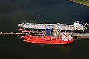 Nederland, Zeeland, Terneuzen, 09-05-2013; Zeeuws-Vlaanderen, Terneuzen. Site van de chemische fabriek van Dow (Dow Chemical Company) aan de Westerschelde. Afgemeerd zijn de olie- en chemicaliën-tanker Sten Hidra (rood oranje) en de  Lpg-tanker BW Tokyo.<br /> De kraakinstallaties maken o.a. benzeen, ethyleen en propyleen (basischemicalien voor halffabrikaten voor verschillende kunststoffen).<br /> Zeeuws-Vlaanderen,  the south-west part of the province of Zeeland site of the chemical plant of Dow Chemical Company. This plant produces benzene, ethylene and propylene, the basis for various plastics. <br /> luchtfoto (toeslag op standard tarieven);<br /> aerial photo (additional fee required);<br /> copyright foto/photo Siebe Swart.<br /> luchtfoto (toeslag op standard tarieven);<br /> aerial photo (additional fee required);<br /> copyright foto/photo Siebe Swart.