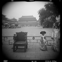 Asia, China, Beijing, Blurred black and white image of tourists posing for snapshots in Imperial era costumes inside Forbidden City