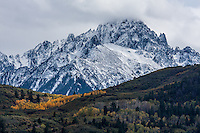 Snow and clouds cover Mount Sneffels after the first snow of the autumn season.  Sneffels Range of the San Juan Mountains, Colorado.