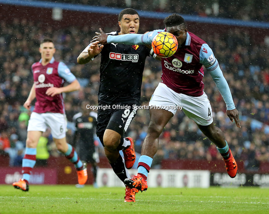28th November 2015 - Barclays Premier League - Aston Villa v Watford -  Micah Richards of Aston Villa gets in front of Troy Deeney of Watford to head away - Photo: Paul Roberts / Offside.