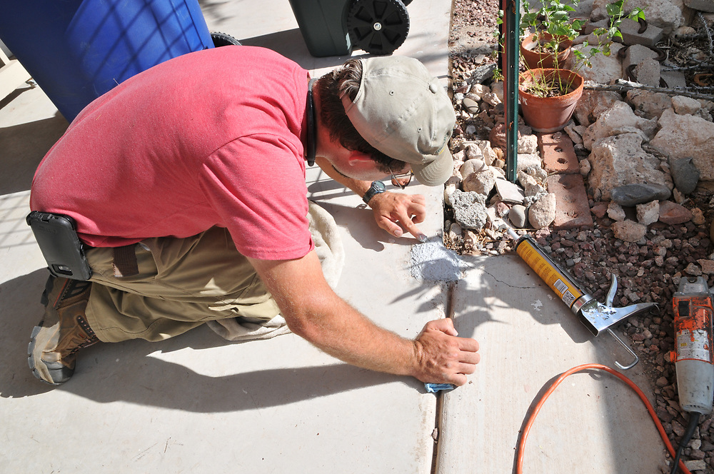 Tucson's Green Handyman, Jesse Micander, fills the space where a porch post used to be.