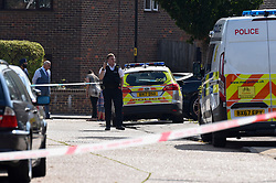 © Licensed to London News Pictures. 25/08/2019. SOUTHALL, UK. A police officer in St Mary's Avenue near Southall in west London.  It is reported that a man in his 60s was stabbed outside The Plough pub on Tentelow Avenue in the early evening of 24 August and stumbled to nearby St Mary's Avenue to seek aid from a residence.  Police were called at 6.41pm, paramedics and air ambulance crews attended but the man passed away.  A man in his 30s has been arrested on suspicion of murder.  The investigation continues. Photo credit: Stephen Chung/LNP