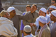 Camel broker Saleh Abdul Fadlallah (second from left) uses his brokering skills to end an argument and finalize a sale at the Birqash Camel Market outside Cairo, Egypt. (Abdul Fadlallah is featured in the book What I Eat: Around the World in 80 Diets.) He is 40 years of age; 5 feet, 8 inches tall and 165 pounds.