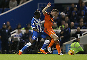 Ipswich Town defender Tommy Smith (5) and Brighton winger, Elvis Manu (19) during the Sky Bet Championship match between Brighton and Hove Albion and Ipswich Town at the American Express Community Stadium, Brighton and Hove, England on 29 December 2015.
