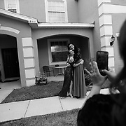 Ariel Zavala, right, poses for a photograph with her friend Alexis Berrios outside of her home Saturday, April 30, 2016 in Tampa. Zavala who is transitioning from male to female attended her prom for Alonso High School on Saturday. CHRIS URSO/STAFF