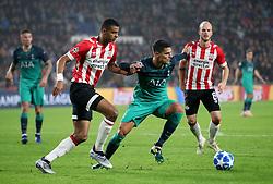 Tottenham Hotspur's Erik Lamela (centre) and Cody Gakpo (left) battle for the ball