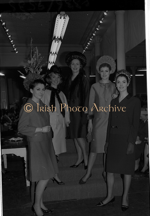 09/03/1964<br /> 03/09/1964<br /> 09 March 1964<br /> McBirney's Fashion show at McBirney's, Aston Quay, Dublin. Group of models taking part in the show (l-r); Mary wearing a red suit; Blanche wearing a yellow suit; Marion wearing a navy suit; Carol wearing a blue suit and Madge wearing a green suit.