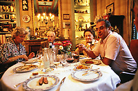 Paul Bocuse at home having dinner with his family, 1983