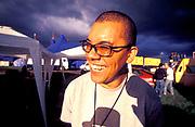 DJ Ashley Beedle smiles for the camera, UK, 2000.