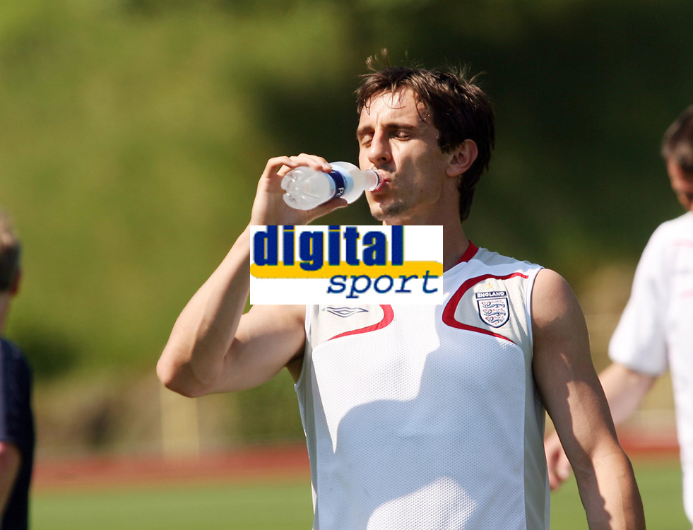 Photo: Chris Ratcliffe.<br />England Training Session. FIFA World Cup 2006. 13/06/2006.<br />Gary Neville takes a drink during training.