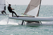 Bryan Roberts (NZL224) rounds the top mark in race three of the A Class World championships regatta being sailed at Takapuna in Auckland. 12/2/2014