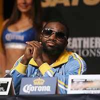 Boxer Adrien Broner listens as he sits during the undercard final press conference for the Mayweather & Maidana boxing match at the Hollywood Theater, inside the MGM Grand hotel on Thursday, May 1, 2014 in Las Vegas, Nevada.  (AP Photo/Alex Menendez)