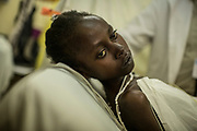 Florence Ndimubakunzi lays on a bed during a screening for Rheumatic heart disease at the University Teaching Hospital of Kigali in Rwanda. Ms. Ndimubakunzi was deemed to sick for surgery.<br /> <br /> Rheumatic heart disease is damage to one or more heart valves that stems from inadequately treated strep throat. Left untreated, rheumatic heart disease leads to heart failure.