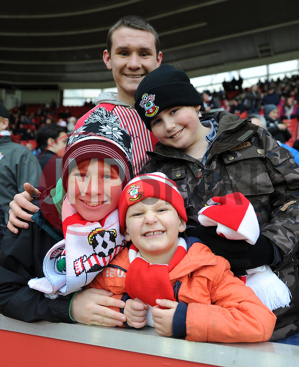 Saints fans wait for the start of the FA Cup Third Round game against Ipswich Town - Photo mandatory by-line: Paul Knight/JMP - Mobile: 07966 386802 - 04/01/2015 - SPORT - Football - Southampton - St Mary's Stadium - Southampton v Ipswich Town - FA Cup Third Round