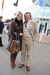 THEO & LOUISE FENNELL at the Hennessy Gold Cup at Newbury Racecourse, Berkshire on 26th November 2011.