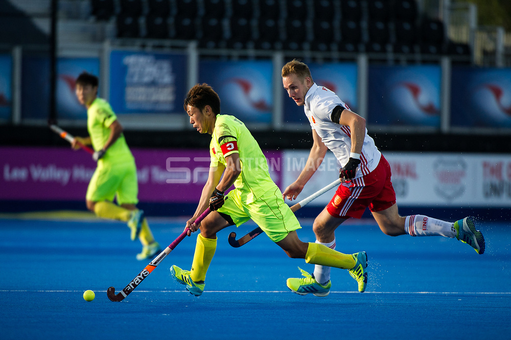 China's Chen Du is watched by David Ames of England. England v China - Hockey World League Semi Final, Lee Valley Hockey and Tennis Centre, London, United Kingdom on 15 June 2017. Photo: Simon Parker