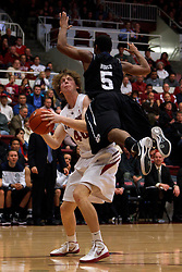Dec 22, 2011; Stanford CA, USA;  Stanford Cardinal forward/center John Gage (40) is fouled by Butler Bulldogs guard Ronald Nored (5) during the first half at Maples Pavilion.  Mandatory Credit: Jason O. Watson-US PRESSWIRE