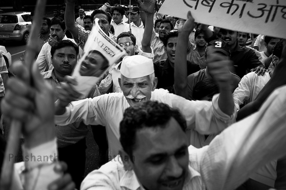 Supporters of social activist Anna Hazare shout slogans against corruptioin New Delhi, India, on Thursday, April 7, 2011. Hazare has vowed to fast to the death to rid India of the corruption he says is its biggest curse. Photographer: Prashanth Vishwanathan