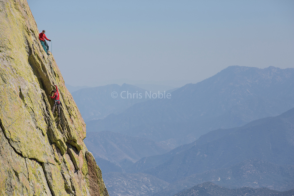 """Conrad Anker belaying Peter Croft on """"Witch Doctor"""" (10b) on """"The Witch,"""" in The Needles of Southern California."""