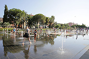 Nice, France Children play in the water of the fountain on Place Masséna (Massena square)