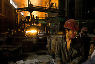 A worker at Baotou steel mill of Baotou Iron And Steel Group (Baogong). This steel mill is Baotou main industrial activity. The whole city relies on it. It is also on of China's biggest steel mill (after Beijing and Shanghai). More than 30 000 people in Baotou work directly for the steel group (a state owned entreprise). A decade ago, they were 100 000. Now the steel mill is growing again, due to high demand for steel.