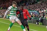 Ryan Christie (#17) of Celtic tackles Christ-Emmanuel Maouassa (17) of Rennes during the Europa League match between Celtic and Rennes at Celtic Park, Glasgow, Scotland on 28 November 2019.