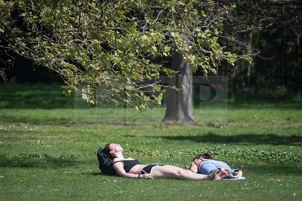 © Licensed to London News Pictures. 22/04/2019. London, UK. Members of the public relax in the heat in Hyde Park, central London on what has been a record breaking Easter bank holiday weekend for temperatures. Photo credit: Ben Cawthra/LNP