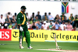 South Africa's captain Hansie Cronje looks at his crumpled stumps after being run out