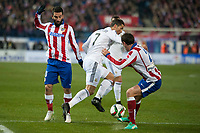 Atletico de Madrid's Diego Godin and Arda Turan and Real Madrid's Cristiano Ronaldo during 2014-15 Spanish King Cup match at Vicente Calderon stadium in Madrid, Spain. January 07, 2015. (ALTERPHOTOS/Luis Fernandez)