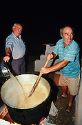 Lisvori. Annual festival of a local Greek Orthodox Chapel. Men preparing lamb and corn stew for all.