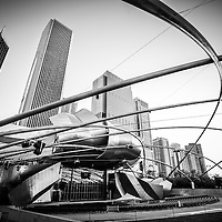 Jay Pritzker Pavilion photo in black and white. Chicago skyline buildings include Aon Center Building, Prudential Plaza, and Prudential Tower