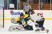 Bishop Guertin's Sarah May Case blocks a shot by Concord's Erin Mullen during Saturday afternoon girls Varsity Hockey at Everett Arena.  (Karen Bobotas/for the Concord Monitor)