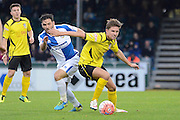 Chesham United midfielder Sam Youngs turns Bristol Rovers midfielder Jake Gosling during the The FA Cup match between Bristol Rovers and Chesham FC at the Memorial Stadium, Bristol, England on 8 November 2015. Photo by Alan Franklin.