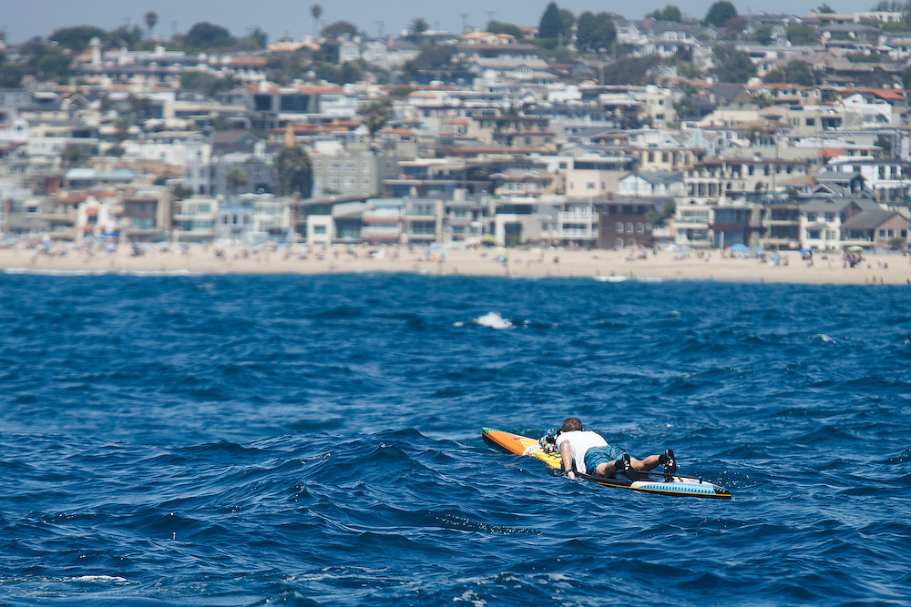 Kevin Cody paddles to the Manhattan Beach pier during the Catalina Classic Paddle board race between Two Harbors and the Manhattan Beach Pier on Sunday, August 30, 2015 in Two Harbors, Calif.  Paddlers start from Two Harbors on Catalina Island, traveling 32 miles through the Pacific Ocean in an endurance feat to end at the Manhattan Beach Pier. © 2015 Patrick T. Fallon
