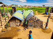 06 NOVEMBER 2014 - SITTWE, RAKHINE, MYANMAR: A Rohingya Muslim IDP camp. After sectarian violence devastated Rohingya communities and left hundreds of Rohingya dead in 2012, the government of Myanmar forced more than 140,000 Rohingya Muslims who used to live in and around Sittwe, Myanmar, into squalid Internal Displaced Persons camps. The government says the Rohingya are not Burmese citizens, that they are illegal immigrants from Bangladesh. The Bangladesh government says the Rohingya are Burmese and the Rohingya insist that they have lived in Burma for generations. The camps are about 20 minutes from Sittwe but the Rohingya who live in the camps are not allowed to leave without government permission. They are not allowed to work outside the camps, they are not allowed to go to Sittwe to use the hospital, go to school or do business. The camps have no electricity. Water is delivered through community wells. There are small schools funded by NOGs in the camps and a few private clinics but medical care is costly and not reliable.   PHOTO BY JACK KURTZ