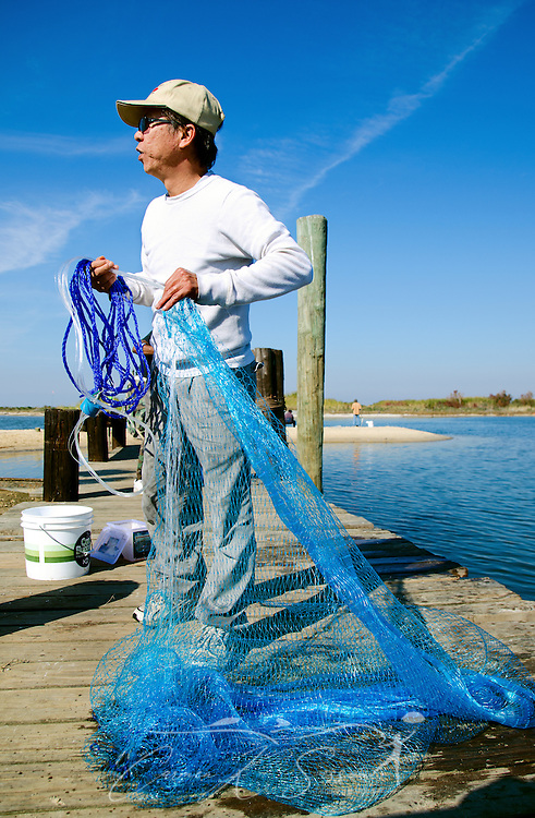 A man prepares to throw a cast net for fish in Bayou La Batre, Alabama, Nov. 23, 2012. (Photo by Carmen K. Sisson/Cloudybright)