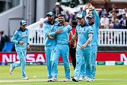 Mark Wood of England celebrates with teammates after taking the wicket of Ross Taylor of New Zealand - Mandatory by-line: Robbie Stephenson/JMP - 14/07/2019 - CRICKET - Lords - London, England - England v New Zealand - ICC Cricket World Cup 2019 - Final