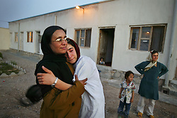 Mejgon, 16, weeps in the arms of her caseworker near fellow residents at an NGO shelter run by Afghan women in Herat, Afghanistan. Mejgon's father sold her at the age of 11 to a 60-year-old man for two boxes of heroin.