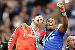 Chelsea's Didier Drogba takes a selfie with Chelsea's Petr Cech - Photo mandatory by-line: Alex James/JMP - Mobile: 07966 386802 - 24/05/2015 - SPORT - Football - London - Stamford Bridge - Chelsea v Sunderland - Barclays Premier League