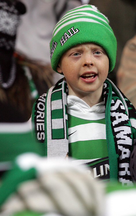 A young Celtic fan cheers on his team. Celtic v Barcelona, Uefa Champions League, Knockout phase, Celtic Park, Glasgow, Scotland. 20th February 2008.