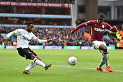 Derby County midfielder Florian Jozefzoon (11) gets in a cross under pressure from Aston Villa defender (on loan from Wolverhampton Wanderers) Kortney Hause (30) during the EFL Sky Bet Championship match between Aston Villa and Derby County at Villa Park, Birmingham, England on 2 March 2019.
