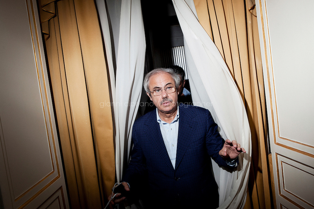 Palermo, Italy - 20 July, 2012: President of the Sicilian Region Raffaele Lombardo, 61, walks out of his office after an interview at Palazzo d'Orleans, headquarters of the Presidency of the Sicilian Regional Assembly on 20 July, 2012, in Palermo, Italy.<br /> <br /> Mario Monti has expressed &ldquo;serious concerns&rdquo; that Sicily&rsquo;s regional government is heading towards default and has asked its governor &ndash; who is under investigation for suspected links to the Mafia &ndash; to confirm his intention to resign. Sicily was among 23 Italian &ldquo;sub-sovereign entities&rdquo; downgraded by Moody&rsquo;s rating agency on Monday, a development that has raised the possibility of a chain of defaults at the local level unless the central government intervenes. Sicily&rsquo;s debt was &euro;5.3bn at the end of 2011, according to Bloomberg. Mr Monti, Italy&rsquo;s technocratic prime minister, indicated in his statement on Tuesday that Rome would take action to bail out Sicily&rsquo;s debts. Sicily has long been identified as one of the most poorly managed of Italy&rsquo;s regions, with the public sector accounting for the bulk of the island&rsquo;s economy and jobs. Commentators call it &ldquo;Italy&rsquo;s Greece&rdquo;.