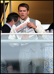 Footballer Michael Owen reading the racing post while watching the races  on  Day 2 of Royal Ascot, Wednesday June 15, 2011. Photo by Andrew Parsons/ i-Images