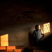 A staff member of the Burundian National Independent Electoral Commission prepare a room at a polling station in Cibitoke neighbourhood in Bujumbura, minutes before the start of the vote for the countryís parliamentary elections., on June 29, 2015.
