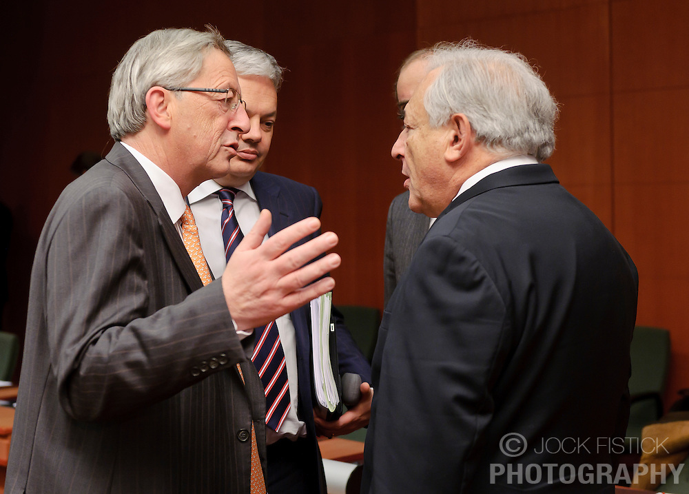 Jean-Claude Juncker, Luxembourg's prime minister, and president of the Eurogroup, left, speaks with Dominique Strauss-Kahn, managing director of the IMF, right, and Didier Reynders, Belgium's finance minister, center, during the Eurogroup meeting in Brussels, Monday Dec. 6, 2010. (Photo © Jock Fistick)