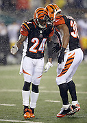 Cincinnati Bengals cornerback Adam Jones (24) and Cincinnati Bengals running back Cedric Peerman (30) low five during the NFL AFC Wild Card playoff football game against the Pittsburgh Steelers on Saturday, Jan. 9, 2016 in Cincinnati. The Steelers won the game 18-16. (©Paul Anthony Spinelli)