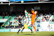 Carlisle Utd goalkeeper Mark Gillespie is fouled by Yeovil Town's Ryan Bird and Yeovil Town's Alex Lacey during the Sky Bet League 2 match between Yeovil Town and Carlisle United at Huish Park, Yeovil, England on 25 March 2016. Photo by Graham Hunt.