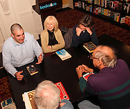 (clockwise from left) Steve Turek of Oakwood, Bonnie Doczy of Springboro, Donna Beddies of Dayton, Joe Hemsky of Fairborn and Eugene August of Kettering during a meeting of the Classics Book Club at Books & Company in The Greene, Monday, March 5, 2012.