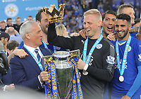 Football - 2015 / 2016 Premier League - Leicester City vs. Everton<br /> <br /> Leicester Manager Claudio Ranieri is handed the Crown from the trophy by Kasper Schmeichel at the King Power Stadium.<br /> <br /> COLORSPORT/ANDREW COWIE